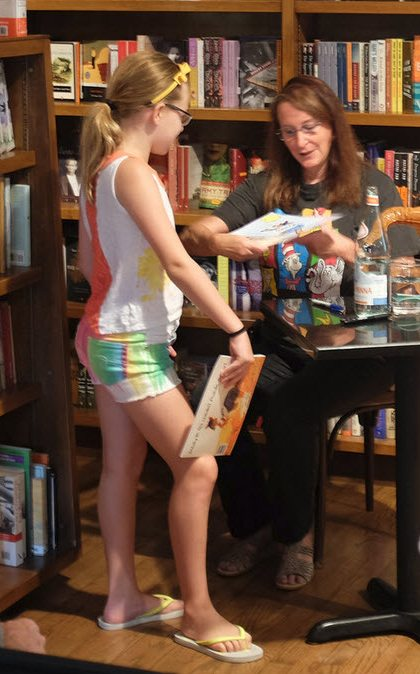 Signing one of two books